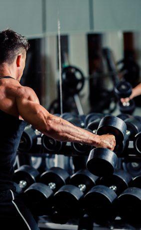 handsome-man-workout-in-gym-PLDJRMA-283x460